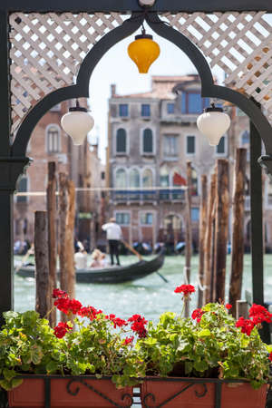 agreeable: window with flowers and a view of the Venice Canal Stock Photo
