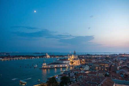 Beautiful sunset in sea shore of Mediterranean sea, Venice, Italy. Venice - San Giorgio church - night.