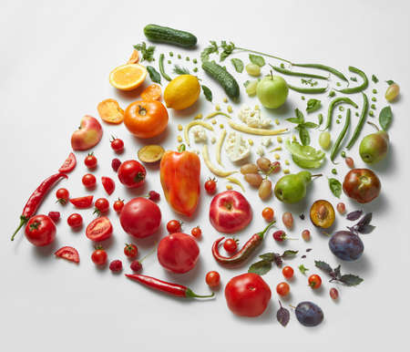vegetables on white: square of healthy different fruits and vegetables isolated on white backdrop. Side view. Healthy eating and food for vegans Stock Photo