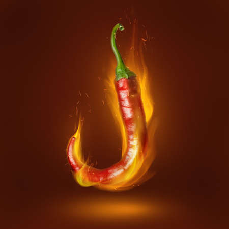 Red hot chili pepper on brown background with flame Stock Photo