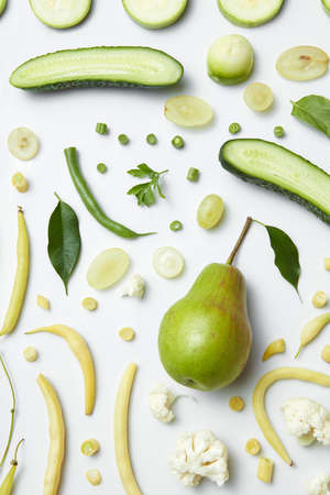 Fruits and vegetables of green color on the white background