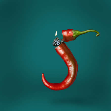 Lighter chili pepper on a green background