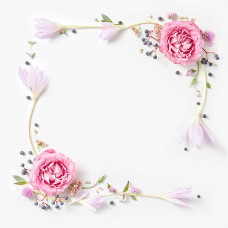 Fresh pink roses frame border isolated and copyspace for text on white background
