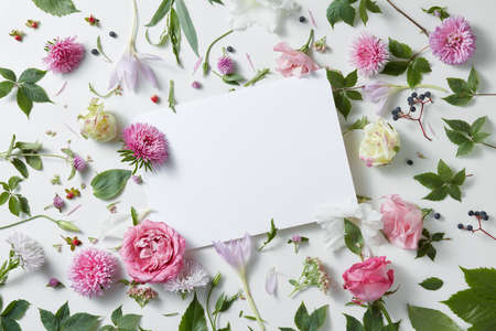 pattern flowers with empty white notebook on a white background, copy space for your text or design