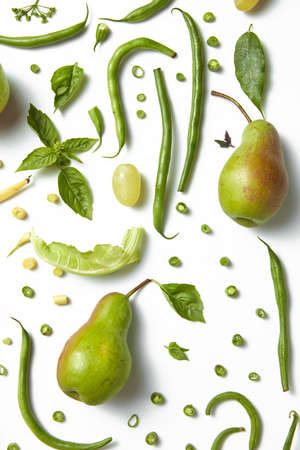 Green healthy drink. Vegetable juice,pears, leaves of basil and beans on the white background. Vegetarian food. Detox