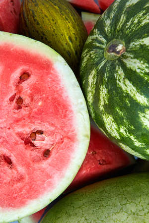 unprocessed: Background of fresh ripe melon, watermelon and slices Stock Photo