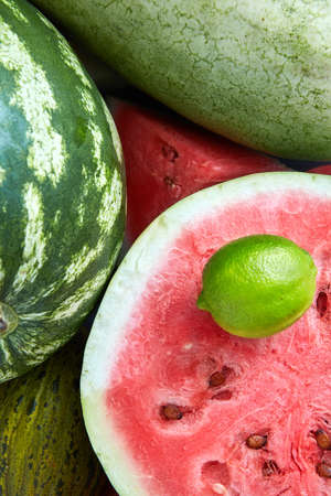 unprocessed: Background of fresh ripe lime, melon, watermelon and slices