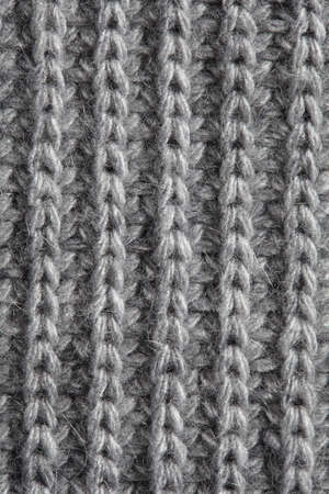 wools: Gray knitted fabric background .Grey knitting wool texture background.