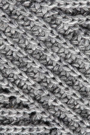 wrinkled: A full page of navy grey knitwear fabric background texture