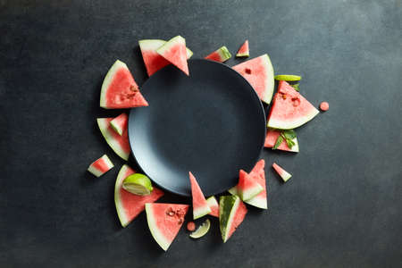 unprocessed: slices of watermelon placed in a circle of black plate. Space for text