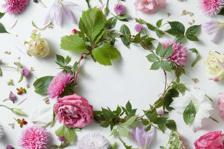 white stones: frame of pink flowers on a white background, copy space for your text or design