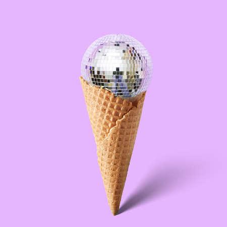 cornet: Waffle cornet with disco ball isolated on purple Stock Photo