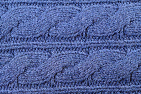interweaving: Blue knitted texture with ornament braids as background