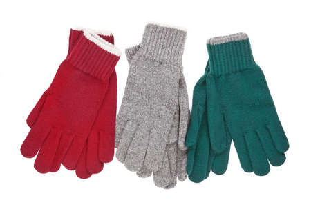 Three pair of colored gloves. Winter accessories isolated on white background.