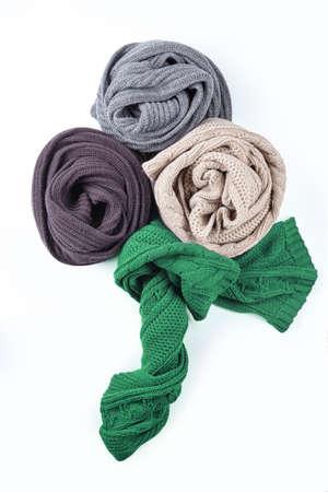 Set of beautiful twisted female scarf isolated on white