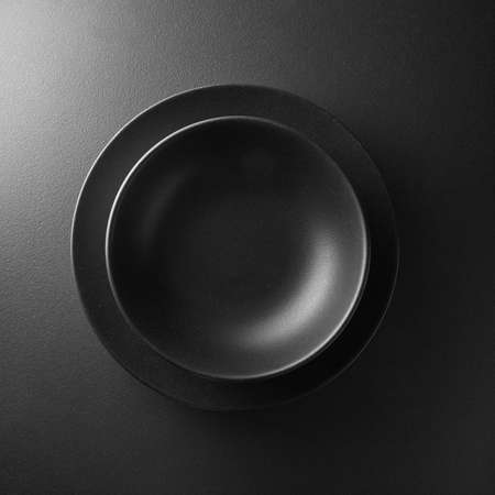 black stone: serving two black plates on the black background Stock Photo