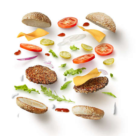 Two burgers with flying ingredients isolated on white background