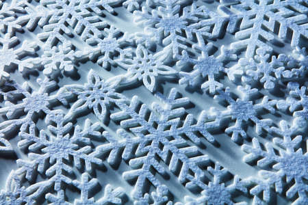 iceflower: Blue and white snowflakes on a blue and white background Stock Photo