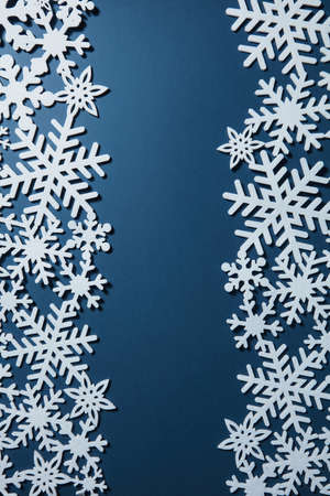 postcard background: Christmas postcard with white snowflakes on blue background.