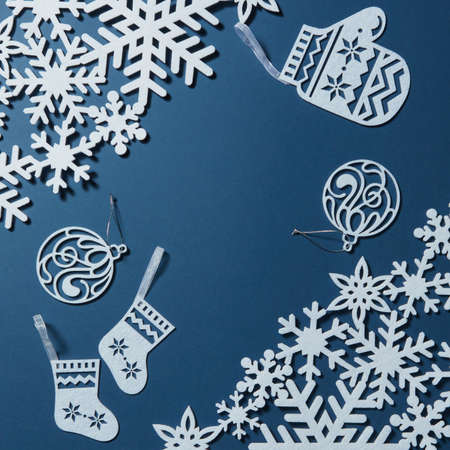 Background for Christmas card with snowflakes and decorations on blue background