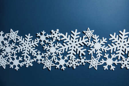 postcard background: Christmas blue background with white snowflakes. Christmas postcard