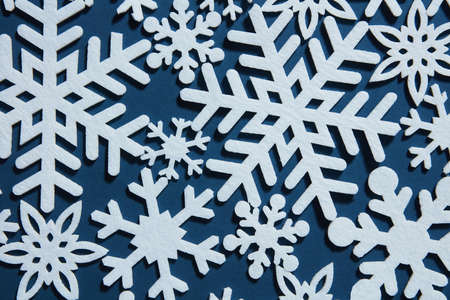 white winter: Beautiful winter background with white snowflakes on a blue background