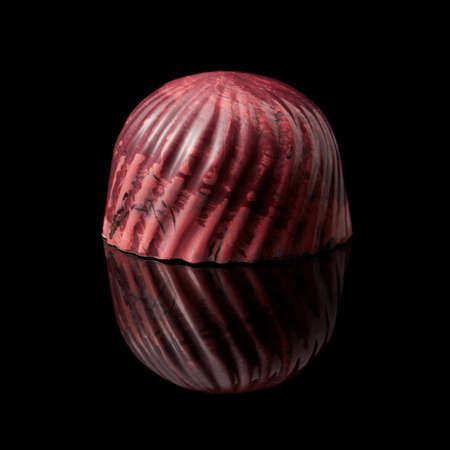 ganache: delicious red chocolate candy on a black background Stock Photo