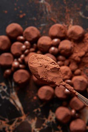 ganache: Luxury chocolate truffles on a black marble background.