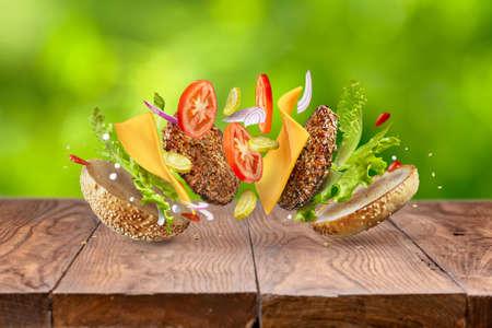 Hamburger ingredients against green background 스톡 콘텐츠