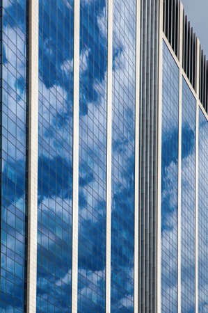 company premises: Glass skyscraper against blue sky