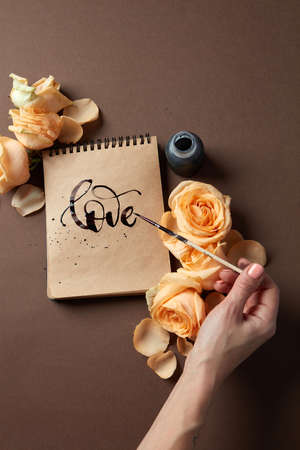 writing letter: Hand with brush writing a love letter