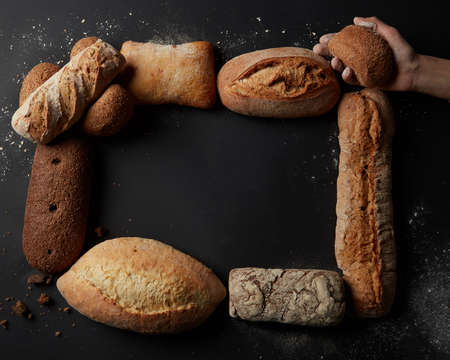 Different kinds of bread on background Stock Photo