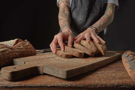 artisan bakery: Baker Holds Bran Bread Stock Photo
