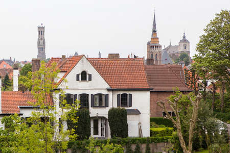 Traditional medieval red and white brickwall architecture of Bruges on blue sky background