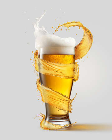 A cold glass of beer and a splash around it isolated on a gray background Stockfoto