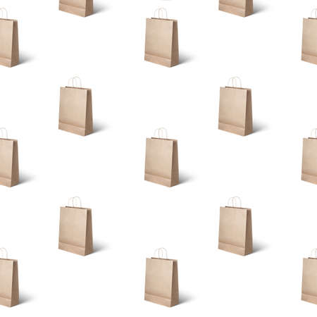pattern of paper bags on a light texture. Concept of sales, can be used as a background