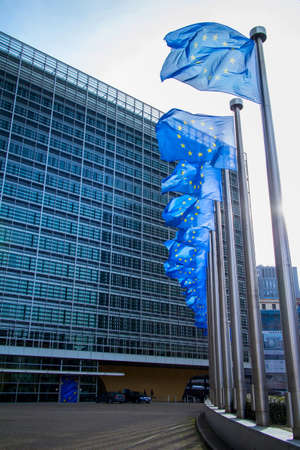 EU flag waving in front of European Parliament in Brussels, Belgium. Toned blue