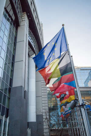Flags with European Parliament in Brussels, Belgium Stock Photo