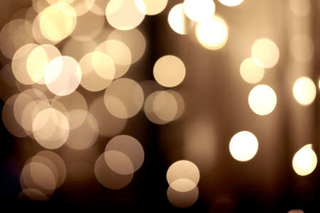 ascendant: Holiday background. Festive abstract background with bokeh defocused lights