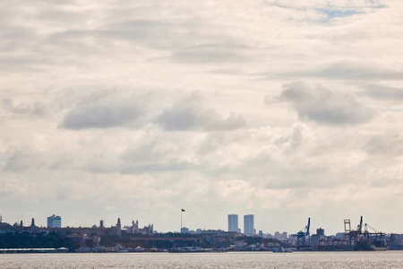 view of the city of Istanbul in the distance. the sky with gray clouds and the sea with ships