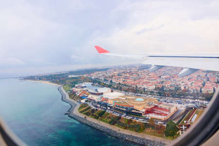 beautiful view from the airplane window to the city and the sea. aerial view Stock Photo