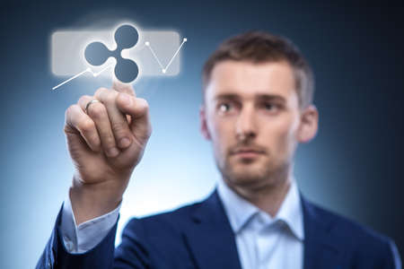 business man touches a ripple icon Stok Fotoğraf