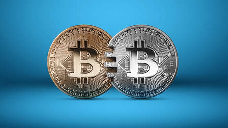 Silver and gold bitcoin coins on a blue background.The concept of blockchain technology and money transfers.  analog concept. Conceptual image for crypto currency market. Can be used for video or site cove