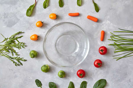 Varied vegetables and herbs and empty glasses, a photo of a step-by-step recipe for salad cooking. Top view, flat lay Stock Photo