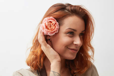 woman with rose flowers in hair isolated on white background
