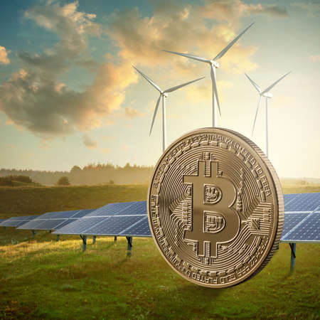 Gold coin bitcoin on a green field against the sky and solar panels. Eco mining concept