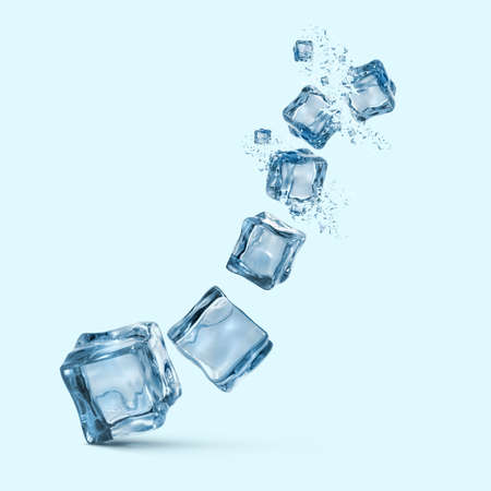 ice cubes with water splashes isolated on blue background