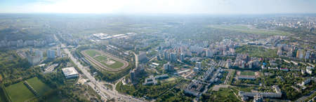 Aerial panoramic view from the drone, a view of the birds eye view of the city of Kiev, a view of the racecourse and the runway Kiev Sikorsky airport in Zhulyany.