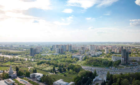 The panoramic birds eye view shooting from drone to modern city district with urban infrastructure and residential buildings of Kiev, Ukraine at summer sunset.