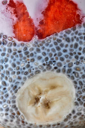 Chia seed parfait made with strawberries, banana and yogurt macro photo Stock Photo